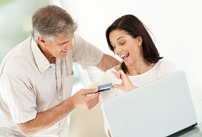 Buy stock photo Portrait of happy mature man giving credit card to his wife for online shopping - Indoor