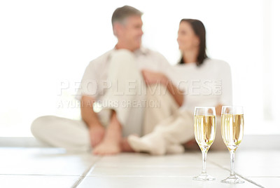 Buy stock photo Portrait of cosy mature couple enjoying champagne together