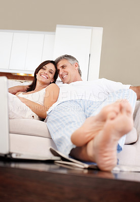 Buy stock photo Portrait of happy mature couple relaxing together in couch and smiling