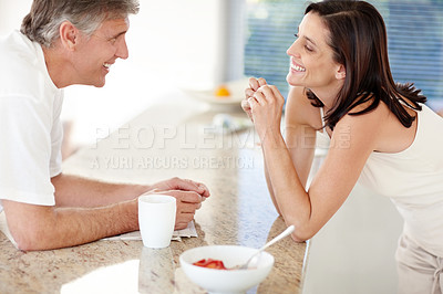 Buy stock photo Portrait of happy mature couple having breakfast together