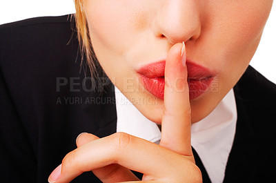 Buy stock photo shh. secret - Young woman with her finger over her mouth