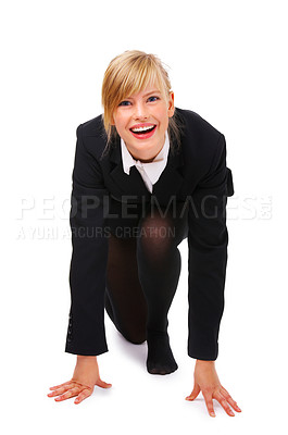 Buy stock photo Portrait of an attractive young woman, in position ready to run. Concept is competition and preparation. Isolated on a white background.