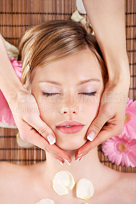 Buy stock photo Young woman lying on massage table at spa, eyes closed.