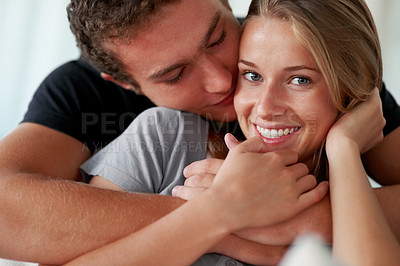 Buy stock photo Closeup portrait of a romantic young couple enjoying themselves