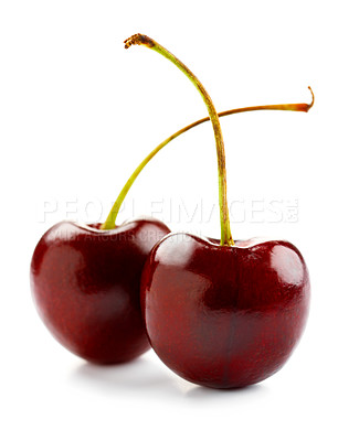 Buy stock photo Shot of two isolated red cherries