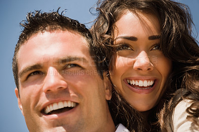 Buy stock photo Close up of a smiling young couple in love. Woman hugging man while both laughing.