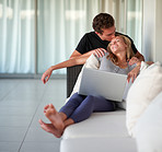 Attractive young couple sitting with laptop