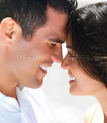 Buy stock photo Close up of a young smiling couple in love