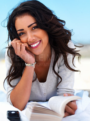 Buy stock photo Portrait of a smiling young woman with book