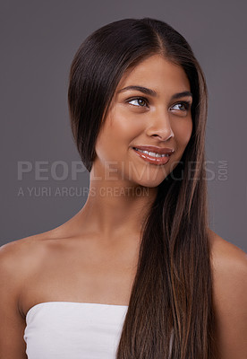 Buy stock photo A young woman with sleek hair posing in studio