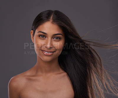 Buy stock photo Portrait of an attractive young woman with windswept hair in studio