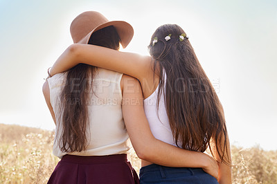 Buy stock photo Rear view of two young friends spending a summer's day outdoors