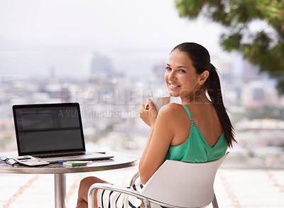 Buy stock photo A woman smiling happily as she looks over her shoulder at the camera