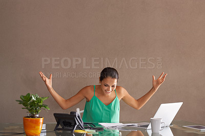 Buy stock photo A woman throwing up her hands in surprise as she works from home