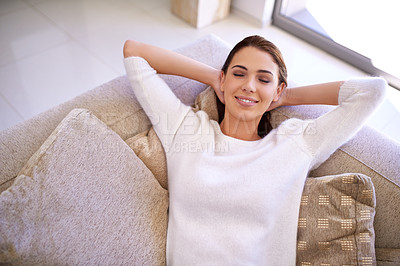 Buy stock photo Portrait of an attractive young woman relaxing at home