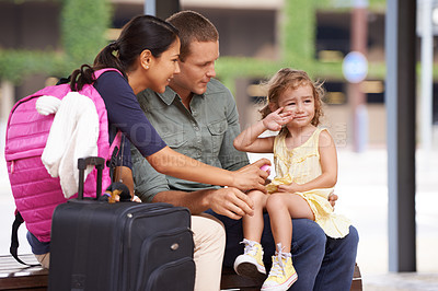 Buy stock photo A cute little girl waves farewell as she goes on holiday with her parents