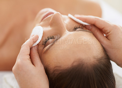 Buy stock photo Cropped shot of a beautiful young woman receiving a facial treatment