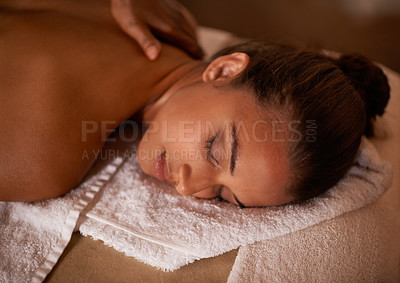 Buy stock photo Shot of a young woman enjoying a relaxing massage at a day spa