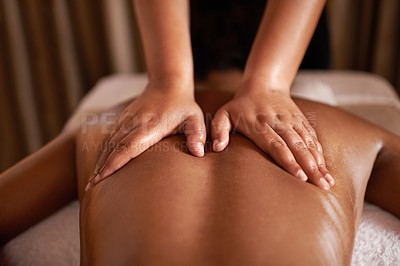 Buy stock photo Rearview shot of a woman getting a massage at a spa