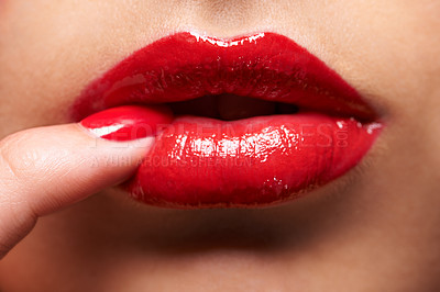 Buy stock photo Cropped shot of a woman pressing her finger against her lip