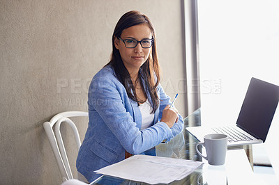 Buy stock photo Shot of an attractive young businesswoman sitting with a laptop at her office desk