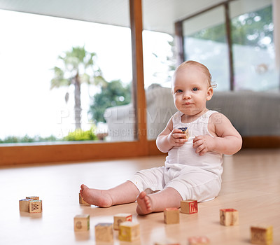 Buy stock photo Shot of a cute and adorable baby boy at home