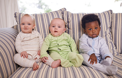 Buy stock photo Portrait of three adorable babies sitting on a couch