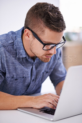 Buy stock photo A young designer working on his laptop