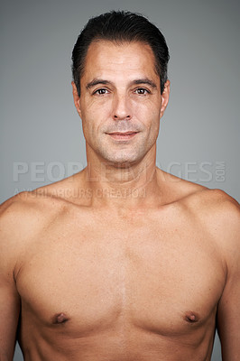 Buy stock photo Studio portrait of a handsome mature man standing against a gray background