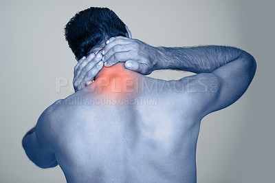 Buy stock photo Rear view studio shot of a mature man rubbing the highlighted injury on his body
