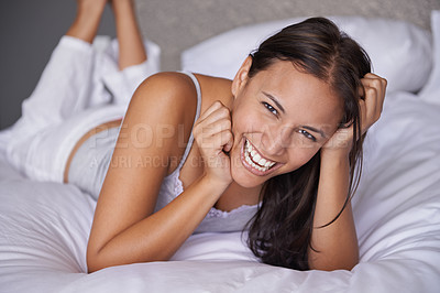 Buy stock photo Cropped shot of a beautiful young woman relaxing on her bed