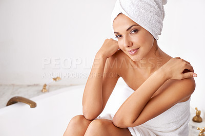 Buy stock photo Portrait of a beautiful young woman relaxing in the bathroom in a towel