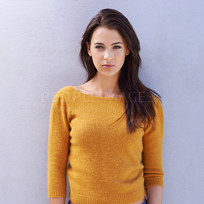 Buy stock photo Portrait of a beautiful young woman standing confidently against a grey wall