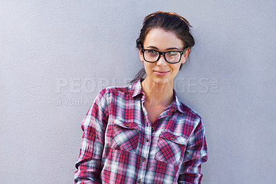 Buy stock photo Portrait of an attractive young woman wearing glasses and a checkered shirt