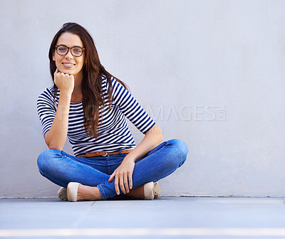 Buy stock photo Full-length portrait of a beautiful young woman sitting on the floor