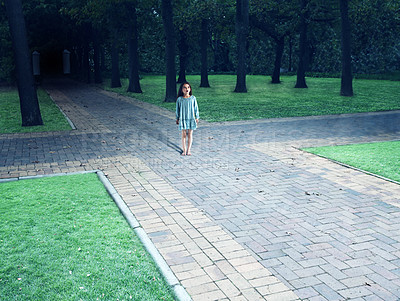Buy stock photo Shot of a child standing in the centre of a four way intersection in the park - ALL design on this image is created from scratch by Yuri Arcurs'  team of professionals for this particular photo shoot