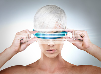 Buy stock photo A futuristic view of a young woman with glasses
