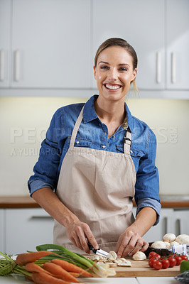 Buy stock photo Portrait of a young woman preparing a meal in a kitchen