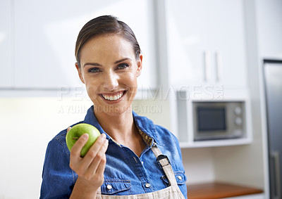 Buy stock photo A young woman holding an apple