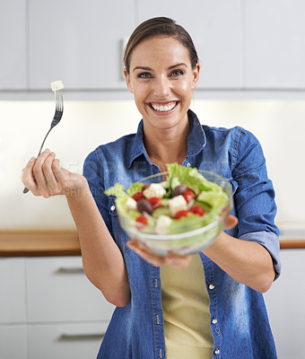 Buy stock photo A young woman enjoying a delicious salad