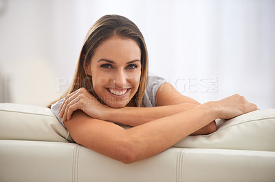 Buy stock photo Portrait of a comfortable woman sitting in her living room