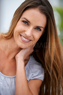Buy stock photo A shot of a woman sitting outdoors