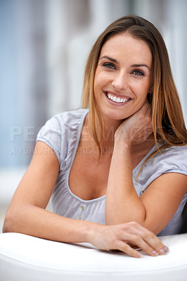 Buy stock photo Portrait of a young woman sitting on her outdoor chair