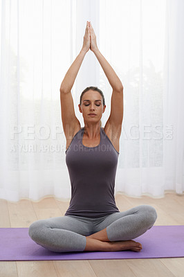 Buy stock photo A portrait of a beautiful young woman doing yoga at home