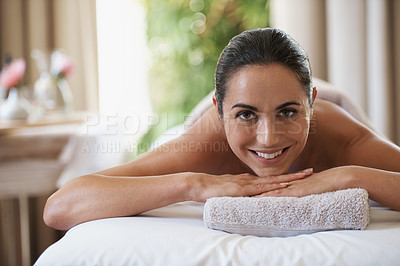 Buy stock photo Portrait of an attractive woman resting on a massage table