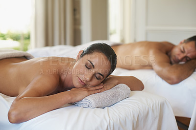 Buy stock photo Shot of a mature couple resting on massage tables