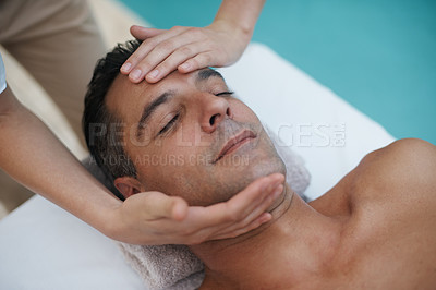 Buy stock photo Cropped shot of a handsome man enjoying a massage at a spa