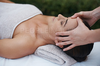Buy stock photo Cropped shot of an attractive woman enjoying a massage at a spa