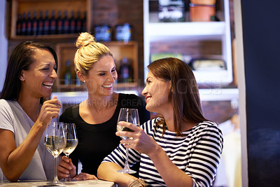 Buy stock photo Cropped shot of three women enjoying a glass of white wine in a restaurant