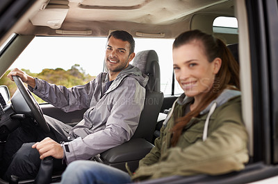 Buy stock photo Portrait of a young couple enjoying a roadtrip
